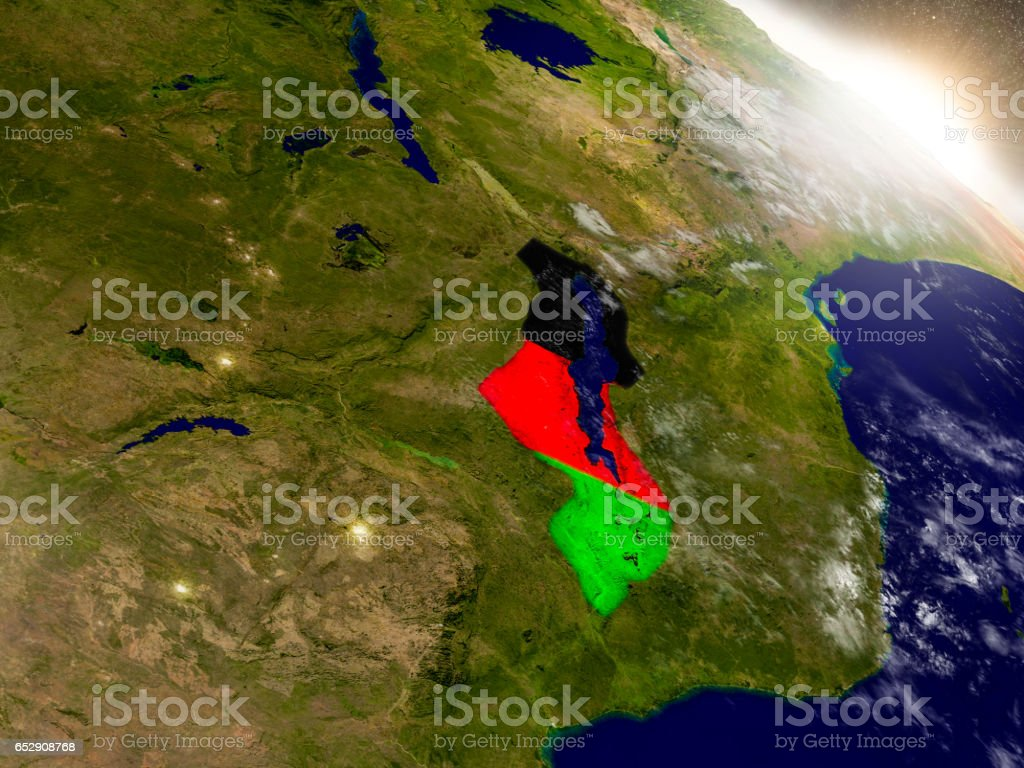 Malawi with flag in rising sun stock photo