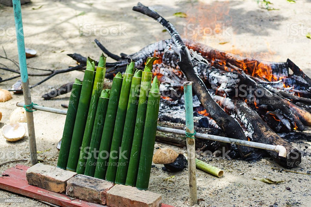 Malay traditional food 'Lemang' over firewood kitchen. stock photo