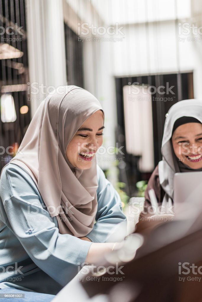 Malay woman using laptop royalty-free stock photo