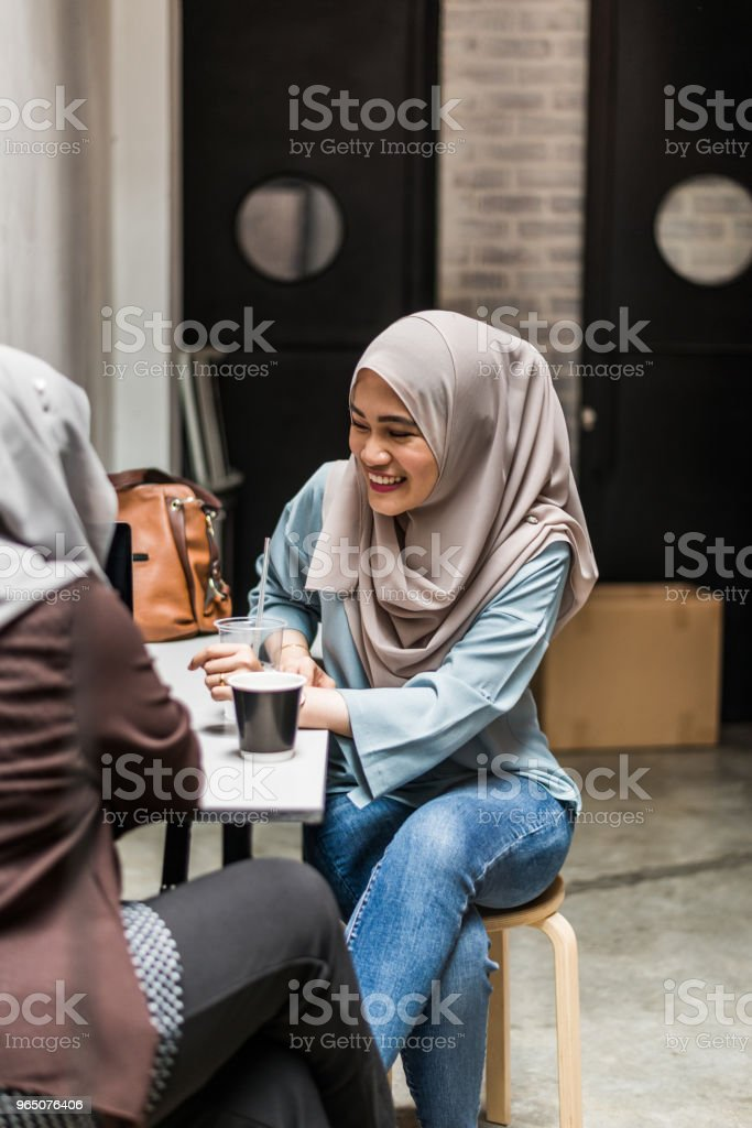 Malay women talk about business royalty-free stock photo
