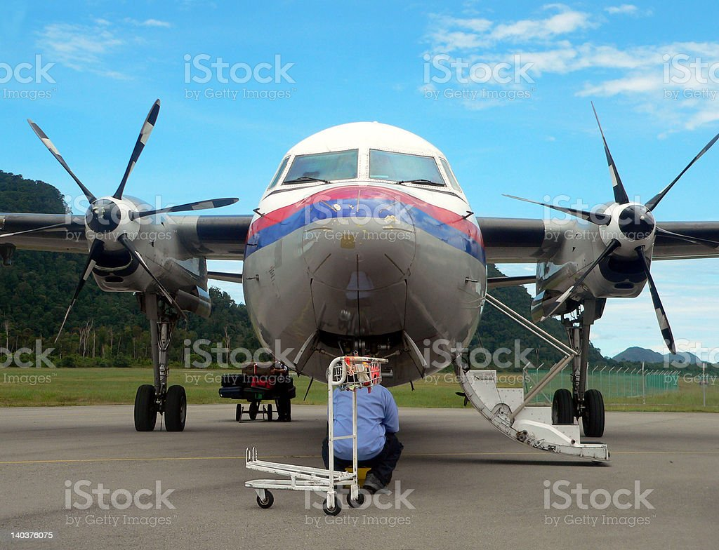 Malaysia. Aircraft Mechanic / Engineer Inspection 2of2 royalty-free stock photo