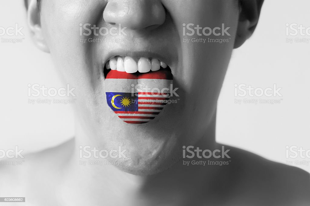 Malaysia and Indonesia flag painted in tongue of a man - foto de acervo