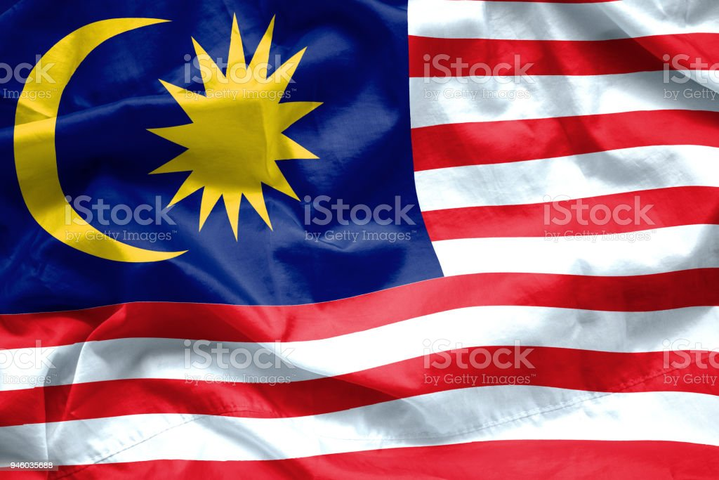 Malaysia Flag background. Closeup of ruffled Malaysia flag blowing in the wind stock photo