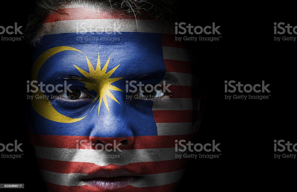 Malásia bandeira no rosto - foto de acervo