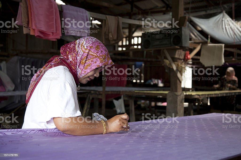 Malaysia, making batik, colorful clothes. stock photo