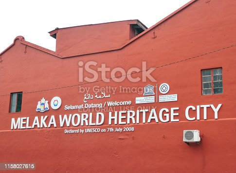 Malacca/Malaysia - 07 28 2018: Melaka Word Heritage City sign on a red painted wall of the building. UNESCO site.