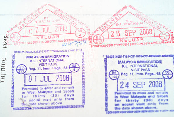 Malaysia passport entry  stamps Malaysia passport entry  stamps pasport malaysia stock pictures, royalty-free photos & images