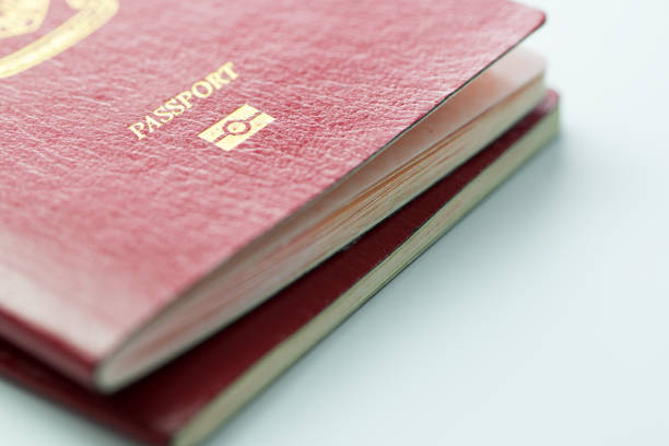 Malaysia passport with ID chip Close up of Malaysia passport with ID chip over white background pasport malaysia stock pictures, royalty-free photos & images