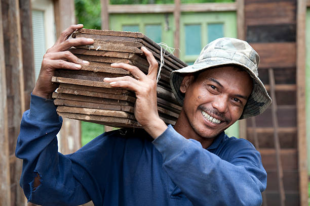 Malaysia, working with tools and building activity. http://www.photodiem.nl/knoppen/malykl.jpg indonesian ethnicity stock pictures, royalty-free photos & images