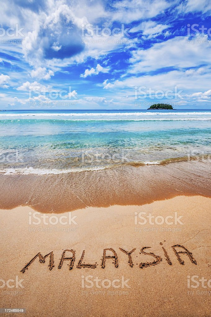Malaysia Written on the Sand stock photo