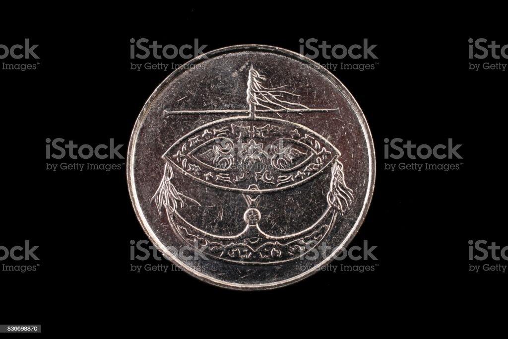 Malaysian 50 sen coin close up on black stock photo