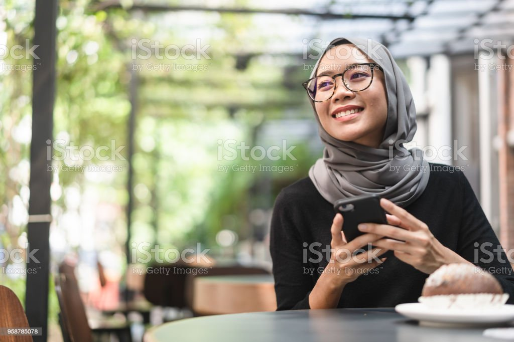Malaysian ambitious businesswoman with smartphone in her hand. stock photo