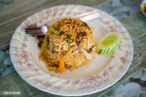 Fresh prepared malaysia beef nasi goreng daging served in local restaurant on Langkawi island. Traditional asian cuisine made of fresh ingredients.