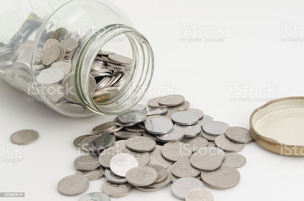 Malaysian Coin with Glass Container stock photo
