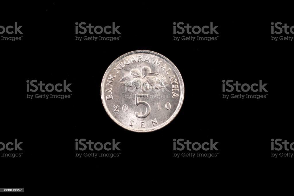 Malaysian five sen coin close up on black stock photo