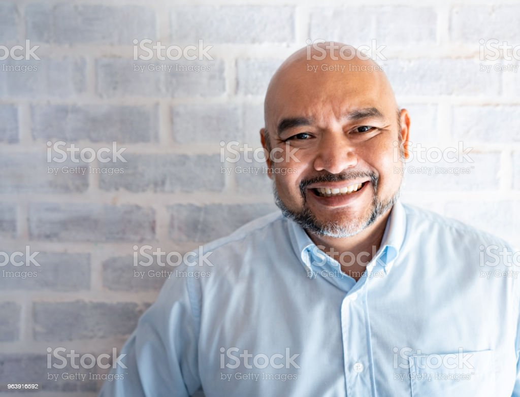 Malaysian man looking very happy - Royalty-free 50-59 Years Stock Photo