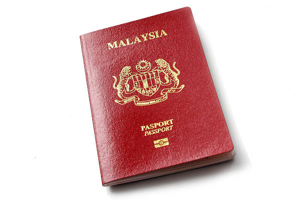 Malaysian Passport Malaysian passport in red colour pasport malaysia stock pictures, royalty-free photos & images