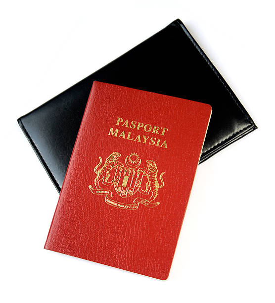 Malaysian Passport with cover Malaysian Passport with cover on white background pasport malaysia stock pictures, royalty-free photos & images