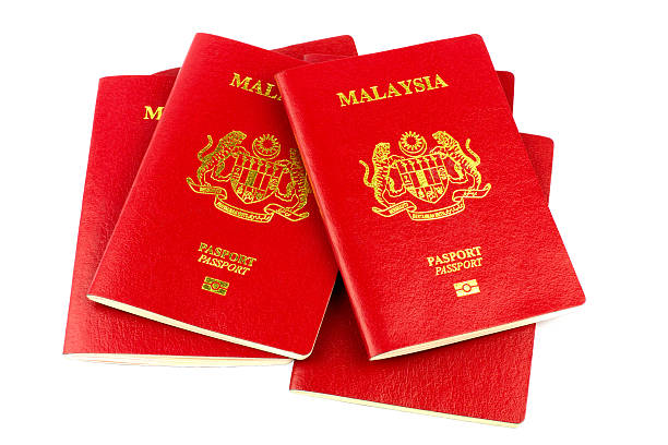 Malaysian Passports on White Background A stack of Malaysian passports isolated on a white background pasport malaysia stock pictures, royalty-free photos & images