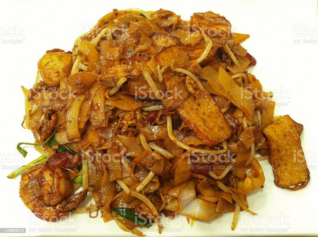 Malaysian stir fried seafood flat noodle isolate stock photo