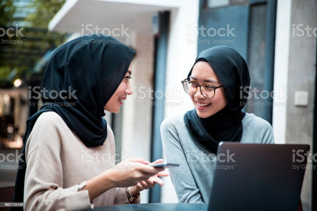 Malaysian Students Wearing Hijab At A Cafe With Their Laptop And Mobile Phone Stock Photo Download Image Now Istock