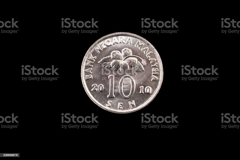 Malaysian ten sen coin close up on black stock photo