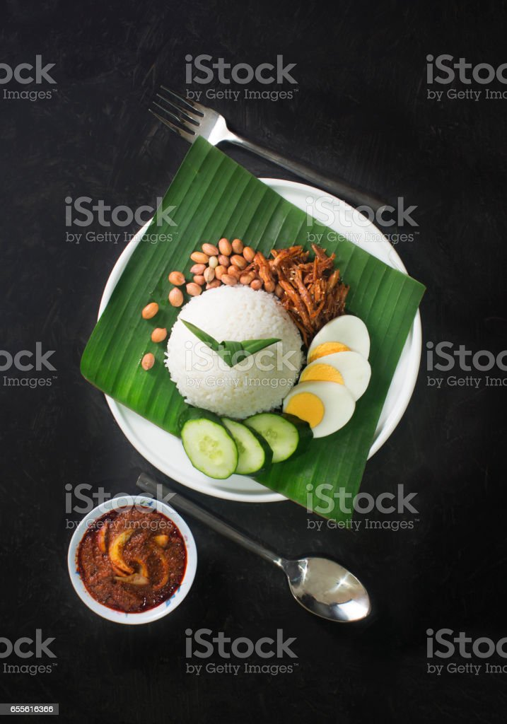 Malaysian traditional food 'Nasi Lemak' on rustic black table top. stock photo