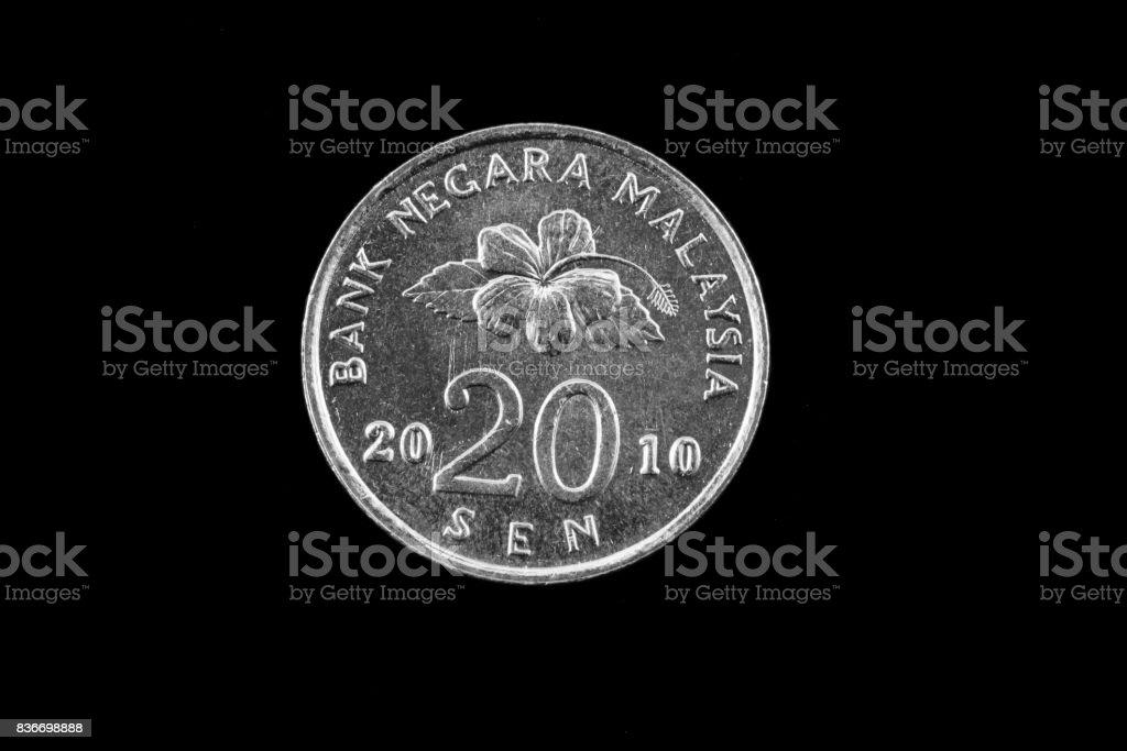 Malaysian twenty sen coin close up on black stock photo