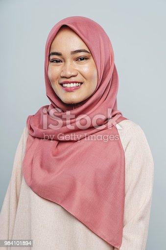 Smiling young malaysian woman wearing hijab portrait. Studio Shot. Kuala Lumpur, Malaysia.