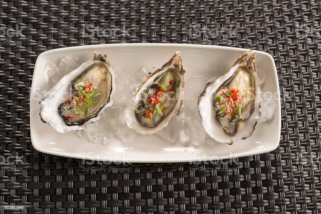 Malden oysters with chilli, ginger & rice wine vinegar stock photo