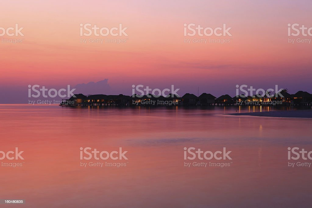 Maldive water villas after sunset royalty-free stock photo