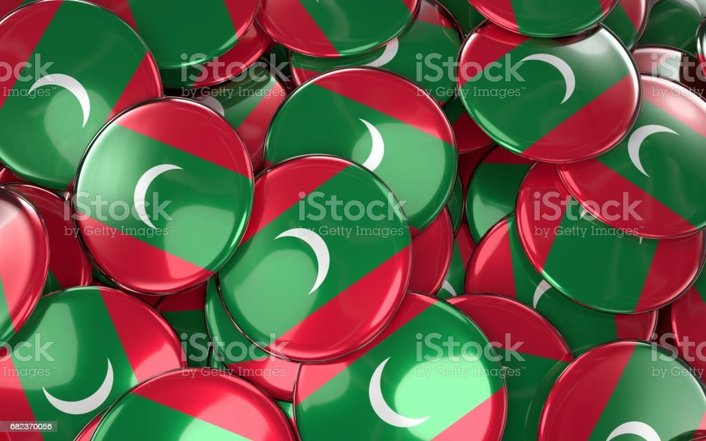 Maldives Badges Background - Pile of Maldivian Flag Buttons. royalty free stockfoto
