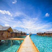 overwater bungalows boardwalk on Maldives