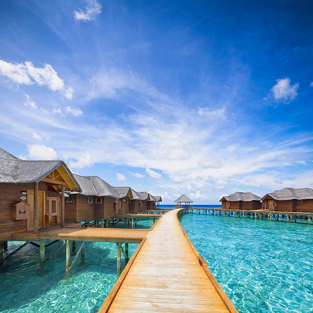 Maldives Boardwalk overwater bungalows boardwalk on Maldives beach hut stock pictures, royalty-free photos & images