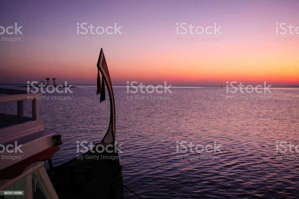 Maldives boat in Sunset stock photo