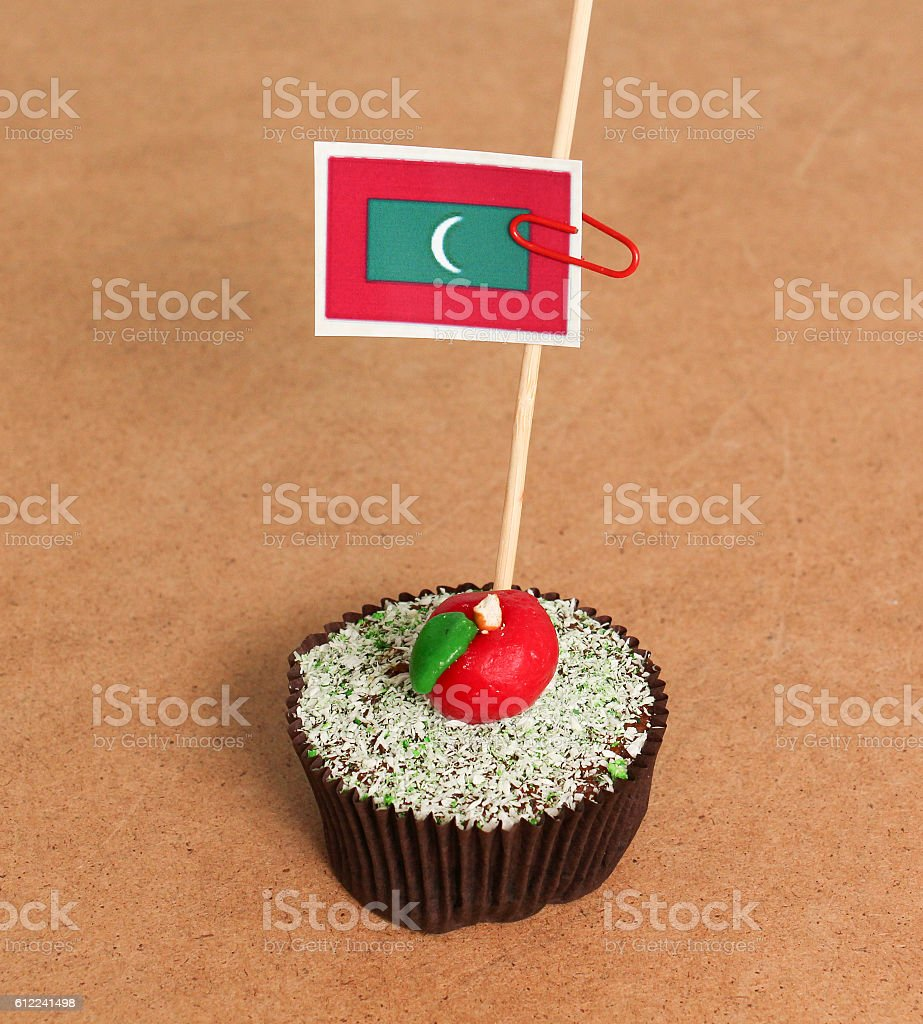 maldives flag on a apple cupcake stock photo