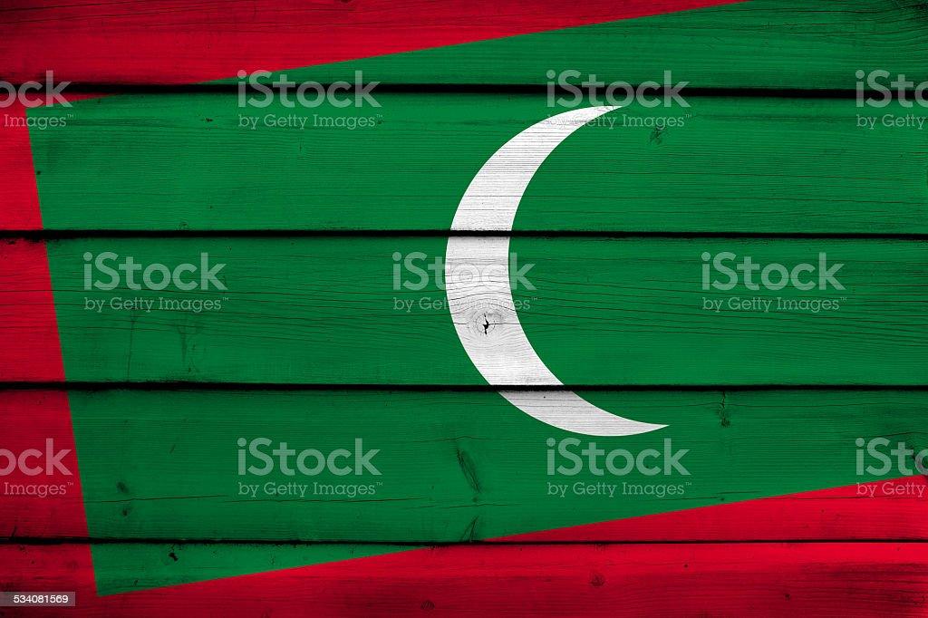 Maldives Flag on wood background stock photo