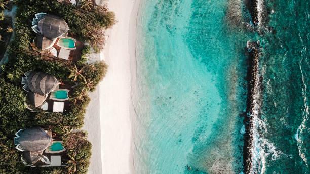 Maldives Island Beach Villas at Lagoon from above stock photo
