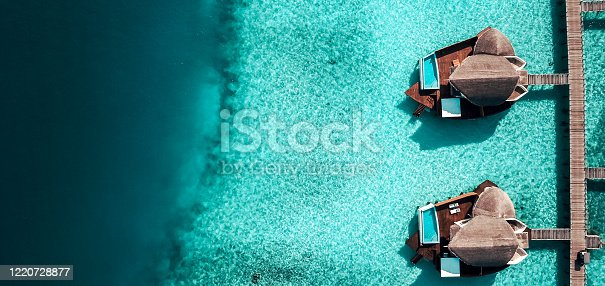 Luxurious Maldives Island Resort Water Villas from above. Over Water Villas are typical for Maldives resorts