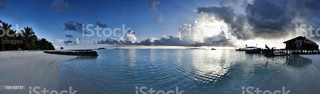 Maldives islands sunset beach panorama stock photo