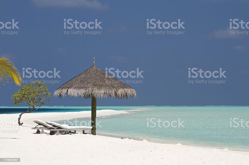 Maldives paradise beach with beach chairs royalty-free stock photo