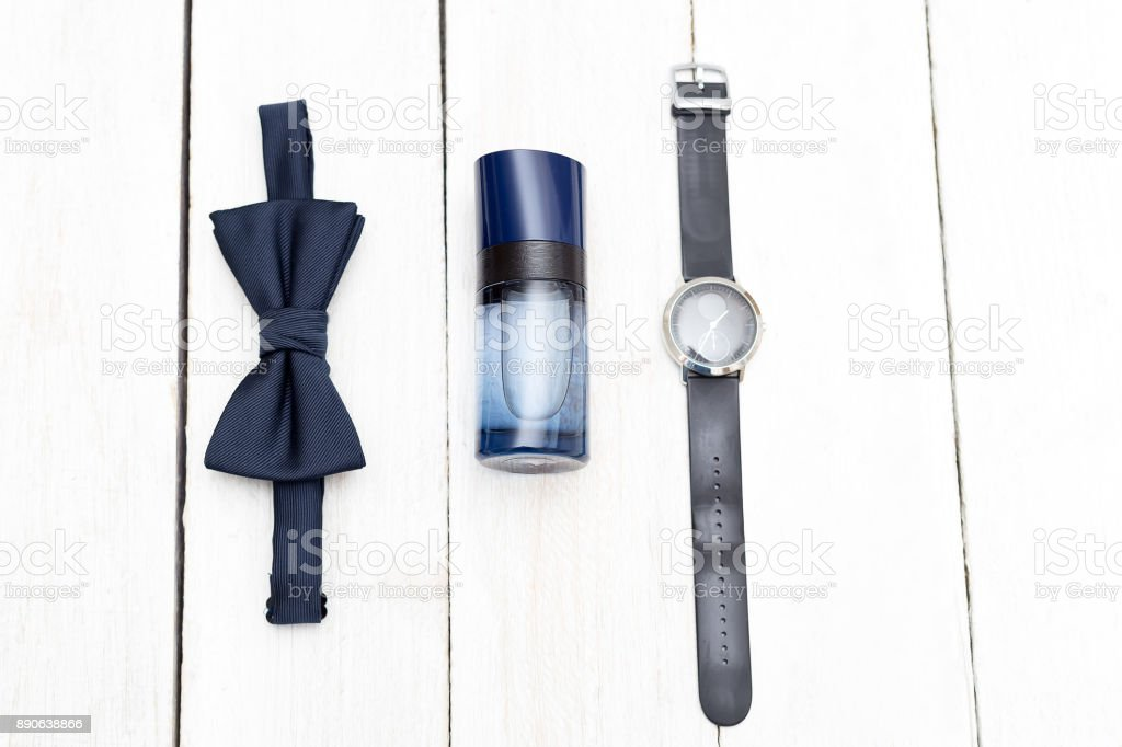 Male accessories on a white wooden background. Flat lay stock photo