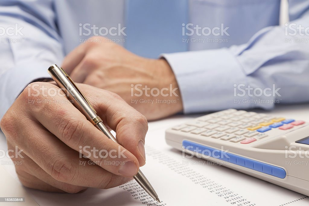 Male accountant calculating taxes (calculator, financial forms) royalty-free stock photo