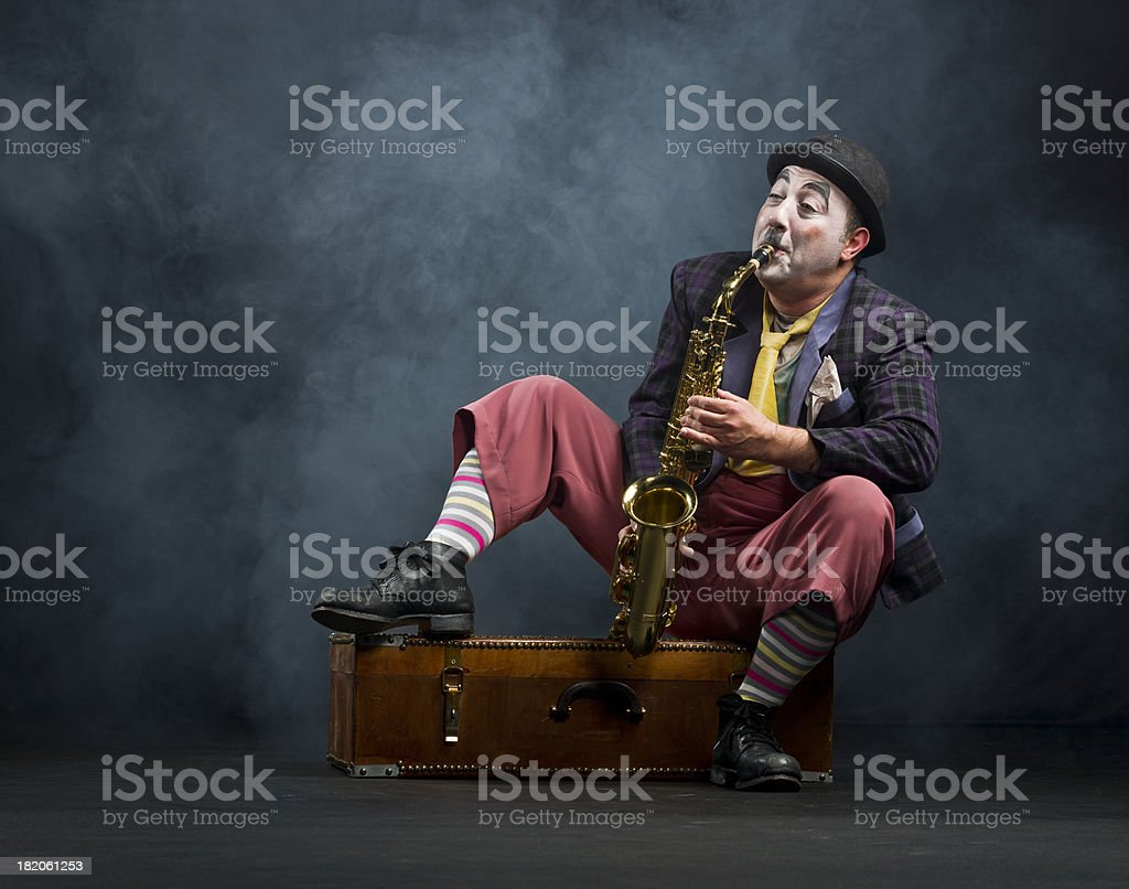 Male actor playing saxophone stock photo