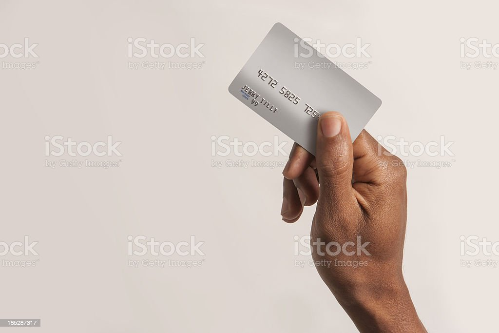 Male African American hand holding fake credit card stock photo