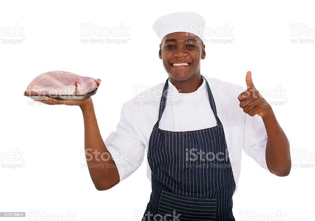 male african butcher holding raw meat stock photo