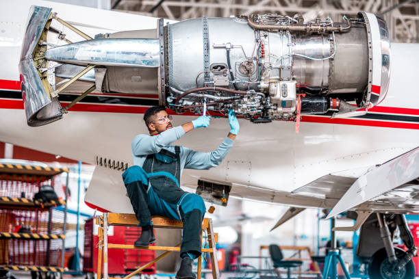 Male aircraft engineer works on the jet engine stock photo