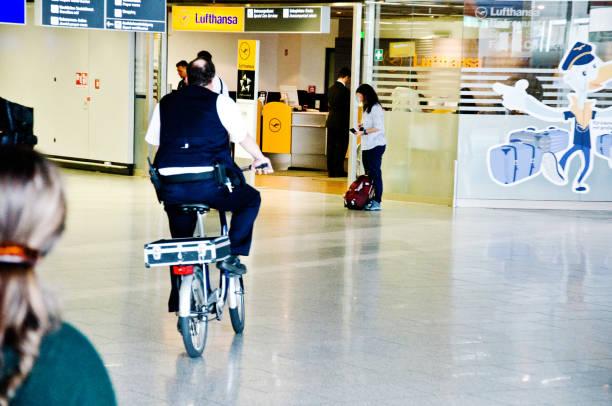 Male airport staff biking through the departure gate in flughafen am picture id1160225978?b=1&k=6&m=1160225978&s=612x612&w=0&h=fwbj5kbvgy0sndiy7hzxmtekuxdsrzye6na17st4tuw=