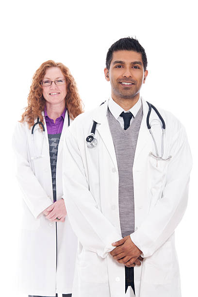 Male & Female Medical Professionals Standing Together stock photo