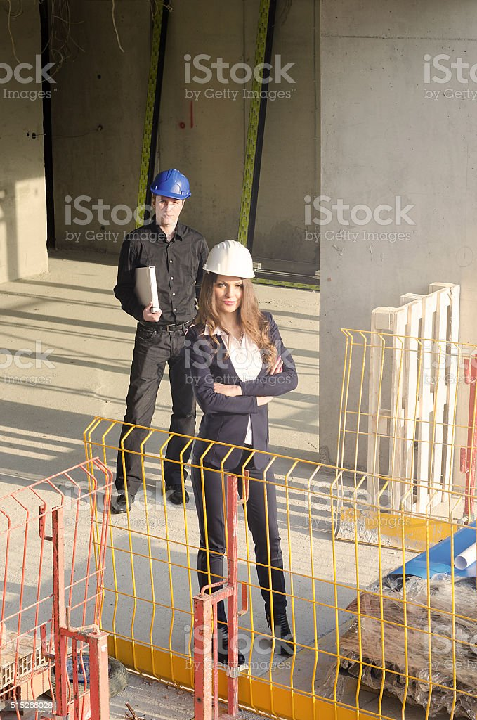 male and female architect on the job stock photo